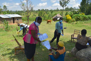 The Water Project: Musango Community, Jared Lukoko Spring -  Distribution Of Handouts To Participants
