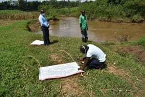 The Water Project: Musango Community, Ham Mwenje Spring -  Facilitators Improvising Stands For Reminder Charts