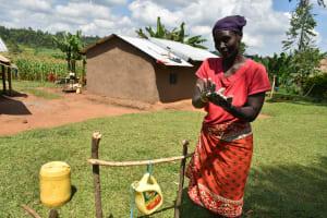 The Water Project: Musango Community, Ham Mwenje Spring -  Regular Cleaning Of Hands Keeps Virus Away