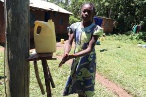 The Water Project: Muraka Community, Peter Itevete Spring -  Using A Homemadhandwashing Station
