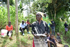 The Water Project: Mungaha B Community, Maria Spring -  A Community Member Addressing The Group