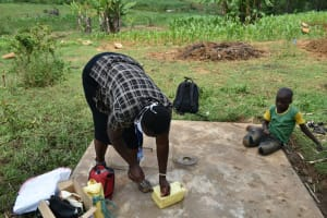 The Water Project: Mungaha B Community, Maria Spring -  The Faciliatator Making A Leaky Tin