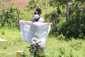 The Water Project: Isembe Community, Amwayi Spring -  The Facilitator Holding Up The Chart