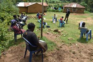 The Water Project: Emaka Community, Ateka Spring -  Mr Wagaka Leading The Training