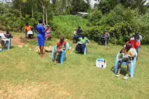 The Water Project: Emaka Community, Ateka Spring -  Mrs Afandi Leading The Training