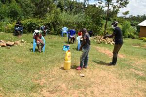 The Water Project: Emaka Community, Ateka Spring -  The Facilitator Demonstrating The Handwashing Exercise