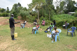 The Water Project: Emaka Community, Ateka Spring -  The Facilitator Insisting On Social Distancing