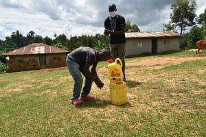 The Water Project: Emaka Community, Ateka Spring -  The Facilitator Leading The Handwashing Exercise