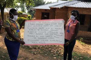 The Water Project: Ematetie Community, Chibusia Spring -  The Facilitators Holding Up The Chart