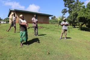 The Water Project: Koloch Community, Solomon Pendi Spring -  Participants Following The Ten Steps Of Handwashing