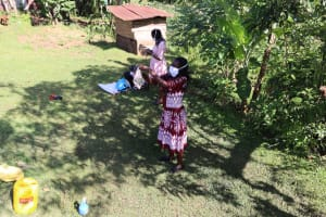 The Water Project: Koloch Community, Solomon Pendi Spring -  Using Cloth To Make Masks
