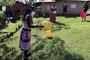 The Water Project: Koloch Community, Solomon Pendi Spring -  Making Handwashing Stations Using Local Materials