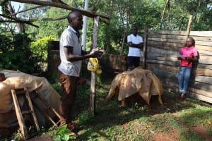The Water Project: Koitabut Community, Henry Kichwen Spring -  A Community Member Illustrates Handwashing