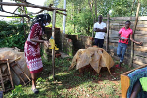 The Water Project: Koitabut Community, Henry Kichwen Spring -  Installing A Leaky Tin Handwashing Station In The Community