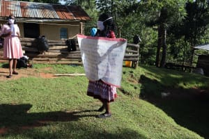 The Water Project: Koitabut Community, Henry Kichwen Spring -  Using Sack With Covid Cautions As Chart At The Training