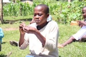 The Water Project: Bukhakunga Community, Khayati Spring -  A Girl Follows The Ten Steps Of Handwashing Keenly