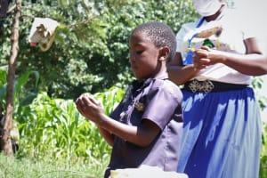 The Water Project: Bukhakunga Community, Khayati Spring -  A Kid Demonstrates Handwashing