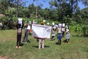 The Water Project: Bukhakunga Community, Khayati Spring -  Community Members Show Training Materials