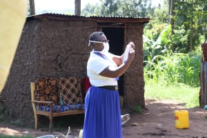 The Water Project: Bukhakunga Community, Khayati Spring -  Demonstration On Making Masks From Home