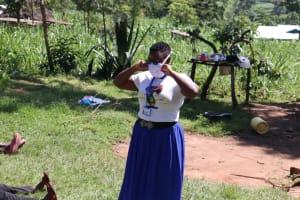 The Water Project: Bukhakunga Community, Khayati Spring -  Facilitator Shows Proper Way Of Wearing Masks