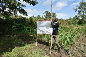 The Water Project: Mukoko Community, Mukoko Spring -  Mr Wagaka Erecting The Poles At The Spring