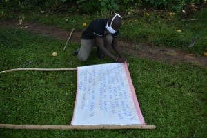 The Water Project: Mukoko Community, Mukoko Spring -  Mr Wagaka Mounting The Chart To The Support Poles