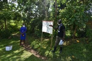 The Water Project: Mukoko Community, Mukoko Spring -  The Facilitator Leading Using The Chart