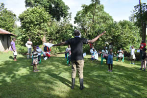 The Water Project: Mukoko Community, Mukoko Spring -  To Find Out If You Have Maintained A Social Distance Just Stretch Like This
