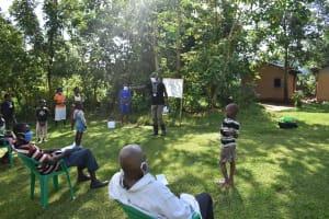 The Water Project: Mukoko Community, Mukoko Spring -  Trainer Erick Emphasizes Caution And Prevention