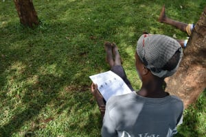 The Water Project: Sichinji Community, Makhatse Spring -  A Community Member Reading Through The Manual