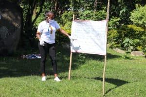 The Water Project: Bukhakunga Community, Mukomari Spring -  Facilitator Explains The Cautions Reminder Chart