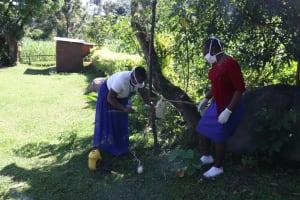 The Water Project: Bukhakunga Community, Mukomari Spring -  Facilitators Setting Up Tippy Tap
