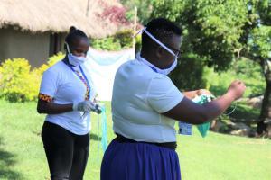The Water Project: Bukhakunga Community, Mukomari Spring -  Facilitators Train Participants On Making Masks At Home