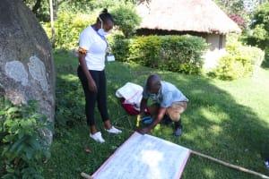 The Water Project: Bukhakunga Community, Mukomari Spring -  Improvising Stand For Setting Reminder Chart