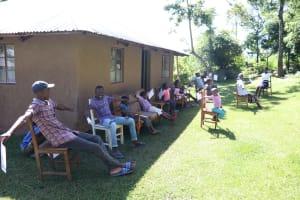 The Water Project: Bukhakunga Community, Mukomari Spring -  Participants Measuring Social Distancing Space