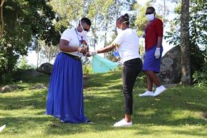 The Water Project: Bukhakunga Community, Mukomari Spring -  Using Cloth To Make Masks From Home