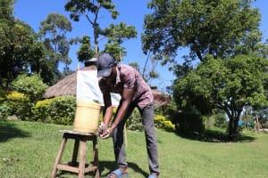 The Water Project: Bukhakunga Community, Mukomari Spring -  Washing Hands From A Leaky Tin