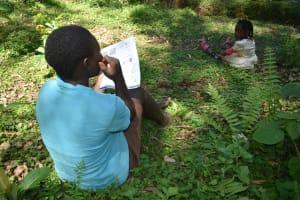 The Water Project: Wajumba Community, Wajumba Spring -  Following Training Using Handouts