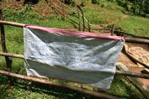 The Water Project: Wajumba Community, Wajumba Spring -  Installed Caution Chart At Spring