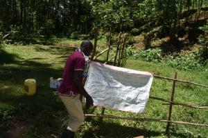 The Water Project: Wajumba Community, Wajumba Spring -  Installing Reminder Chart At The Spring