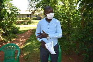 The Water Project: Musango Community, Mwichinga Spring -  A Community Mobilizer Addressing Community Members