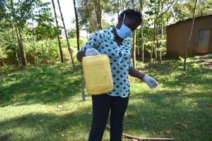 The Water Project: Musango Community, Mwichinga Spring -  Constructing A Leaky Tin