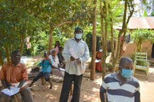 The Water Project: Musango Community, Mushikhulu Spring -  Community Elder Reacting To The Training