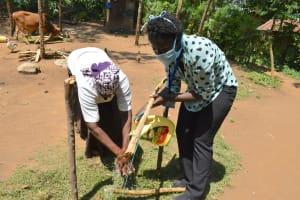 The Water Project: Musango Community, Mushikhulu Spring -  Using Set Up Handwashing Station