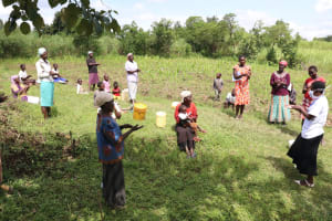 The Water Project: Mukhuyu Community, Kwawanzala Spring -  Handwashing Was A Communual Exercise