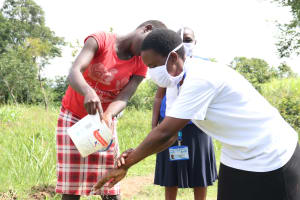 The Water Project: Mukhuyu Community, Kwawanzala Spring -  Rinse Your Hands Using Clean Running Water