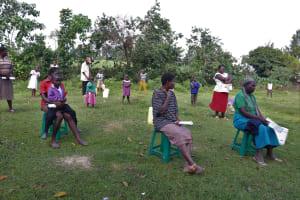 The Water Project: Mukhuyu Community, Kwakhalakayi Spring -  Community Members Litening To The Facilitator