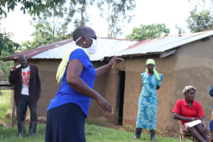 The Water Project: Mukhuyu Community, Kwakhalakayi Spring -  Ms Kayi Stressing The Importance Of Maintaining A Social Distance Of At Least Two Meters