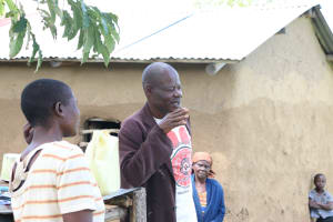 The Water Project: Mukhuyu Community, Kwakhalakayi Spring -  Sir Charles The Chairperson Addressing The Community Members