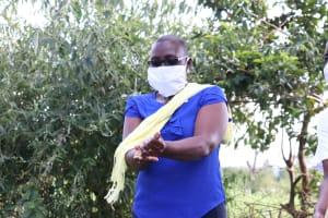 The Water Project: Mukhuyu Community, Kwakhalakayi Spring -  The Facilitator Demonstrating The Ten Steps Of Handwashing